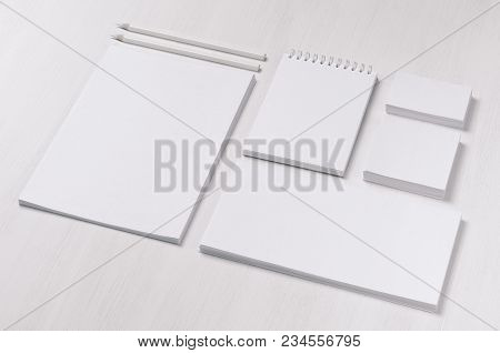 Branding Business Mock Up Of White Blank Stationery Set On Light Soft White Wooden Background, Incli