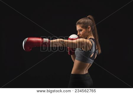 Side View Of A Gorgeous Young Woman With Boxing Gloves, Standing In Position, Ready To Fight, Copy S
