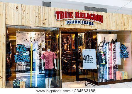 Indianapolis - Circa April 2018: True Religion Brand Jeans Retail Mall Location. True Religion Sells