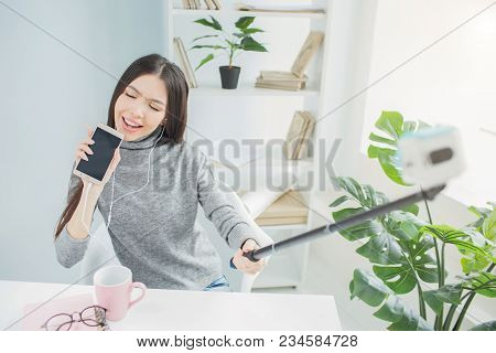 Funny Girl Pretends She Is Singing A Song And Using A Phone Instead Of Microphone. She Is Singing Wi