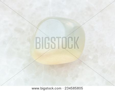 Macro Shooting Of Natural Mineral Rock Specimen - Polished Translucent Moonstone Gem Stone On White