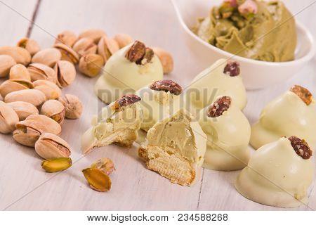 Pistachio Truffles With Pistachio Cream On Black Dish.