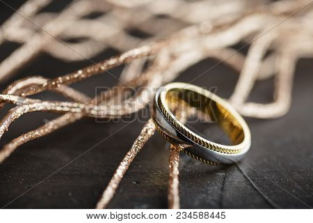 Silver And Gold Ring On Black Background. Male Fashion Jewelry. Wedding Ring