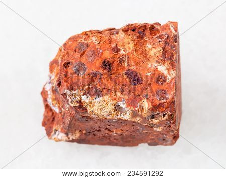 Macro Shooting Of Natural Mineral Rock Specimen - Raw Red Bauxite Stone On White Marble Background