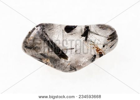 Macro Shooting Of Natural Mineral Rock Specimen - Tumbled Quartz Stone With Tourmaline Crystals (tou