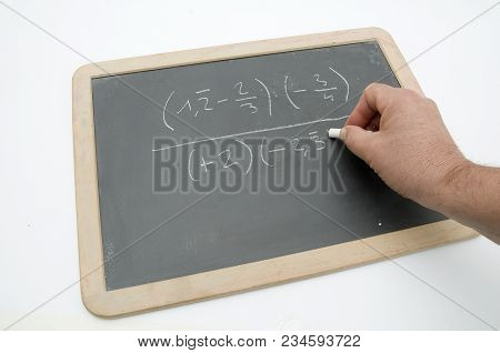 A Mathematical Equation Performed On The Blackboard