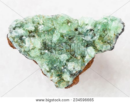 Macro Shooting Of Natural Mineral Rock Specimen - Raw Crystals Of Anapaite Gemstone On White Marble