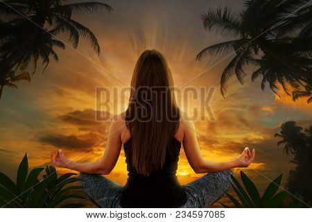 Young Woman In Yoga Position And Meditation