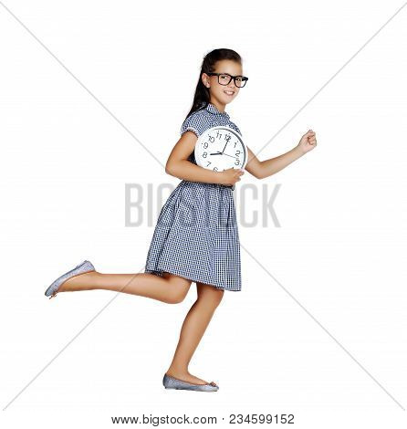 Schoolgirl Holding Wall Clock In A Hand Running Against White Background