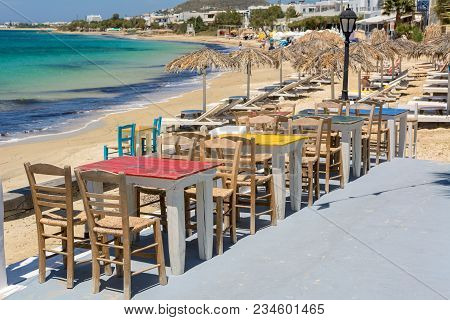 Tables With Chairs In Typical Greek Tavern On Agia Anna Beach, Naxos Island. Greece.