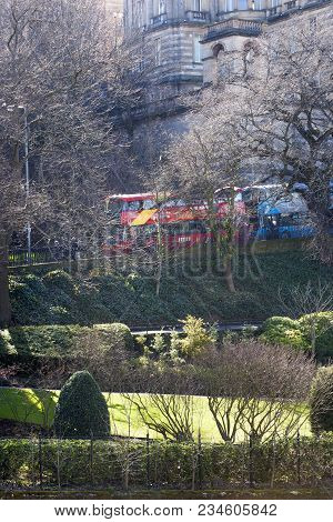 Princes Street Garden With Double-decker Busses In The Background On A Sunny Day In Edinburgh