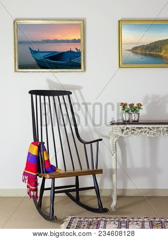 Classic Rocking Chair And Desktop Planter On Old Style Vintage Table On Background Of Off White Wall