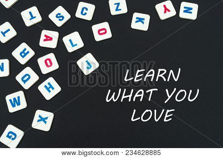 English School Concept, Text Learn What You Love, Colored Square English Letters Scattered On Blackb