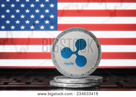 Ripple (xrp) Cryptocurrency; Physical Concept Ripple Coin On The Background Of The Flag Of United St