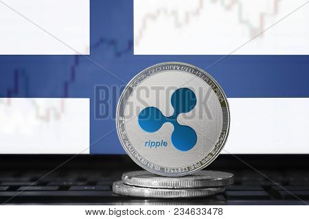 Ripple (xrp) Cryptocurrency; Physical Concept Ripple Coin On The Background Of The Flag Of Finland (