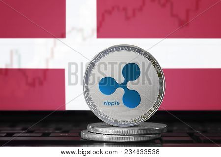 Ripple (xrp) Cryptocurrency; Physical Concept Ripple Coin On The Background Of The Flag Of Denmark (