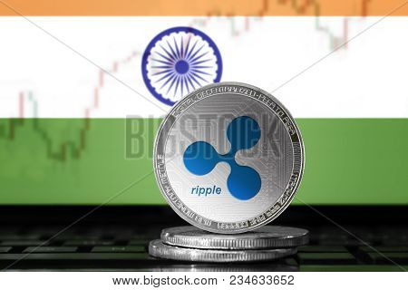 Ripple (xrp) Cryptocurrency; Physical Concept Ripple Coin On The Background Of The Flag Of India