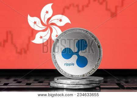 Ripple (xrp) Cryptocurrency; Physical Concept Ripple Coin On The Background Of The Flag Of Hong Kong