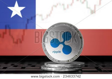 Ripple (xrp) Cryptocurrency; Physical Concept Ripple Coin On The Background Of The Flag Of Chile