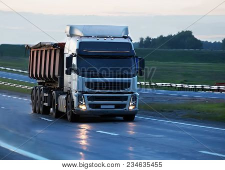 Big Dump Truck Goes On Country Highway