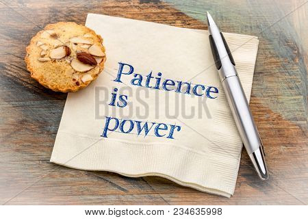 Patience is power - inspiraitonal handwriting on a napkin with a cookie