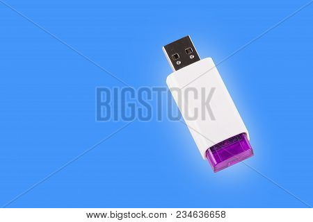 Universal Serial Bus Usb Drive Isolated Over The Blue Background.