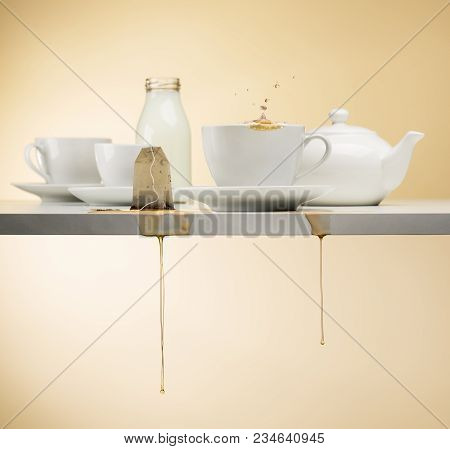 Cup Of Tea On White Table With Wet Tea Bag Dripping