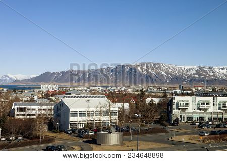 Mount Esja Looms Over The City Of Reykjavik In Iceland