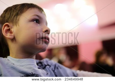 Boy Watching Theatrical Performance