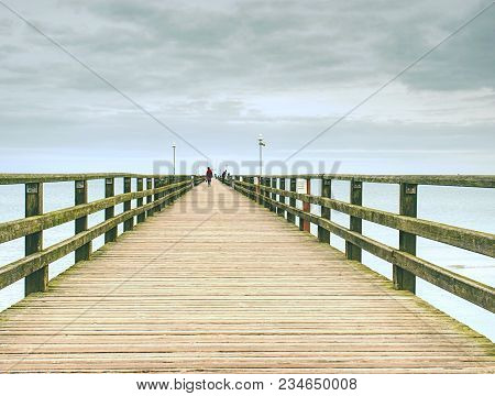 Wooden Pier In Summer Holiday Destination. Late Summer Landscape With Cloudy Sky.  Baltic Sea Coast