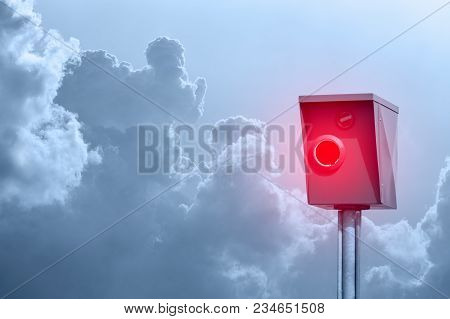 A Typical Radar Trap, Speed Trap, Speed Camera In Front Of Cloudy Sky.
