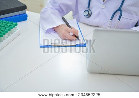 Doctor Concept. Smiling Doctor Posing In The Office. Young Doctor Is Wearing A Stethoscope. Medical