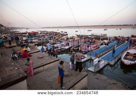 VARANASI, INDIA - MAR 17, 2018: Banks on the holy Ganges river. According to legends, the city was founded by God Shiva about 5000 years ago.