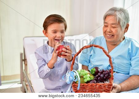 Patient Concept. Grandma's In The Hospital. Waiting For Someone To Visit. Grandchildren Visit Grandm