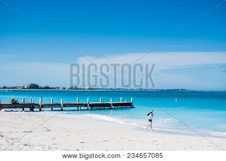 Pier In Beautiful Beach With Turquoise Water In Grace Bay, Providenciales, Turks And Caicos.