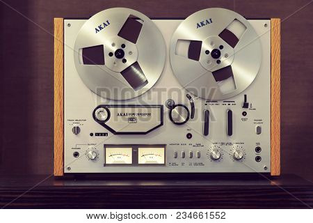 Vintage Open Reel-to-Reel Tape Deck Stereo Recorder with VU meters and knobs