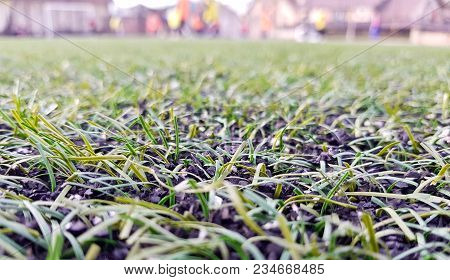 Close-up Synthetic Grass Of Football (soccer) Sport Field. Pattern Of Green Artificial Turf