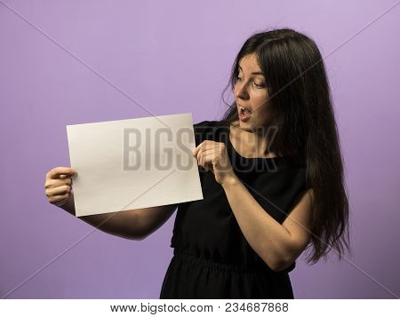 Surprised Young Girl Holding Empty Blank White Board. Leaflet Presentation. Pamphlet Hold Hands. Gir