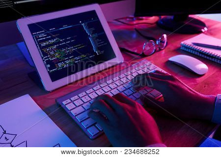 Close-up Shot Of Unrecognizable Programmer Making Necessary Corrections In Brand New Computer Applic