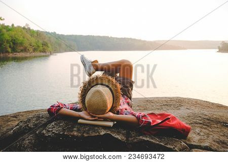 Relaxing Moments, Asian Young Boy Relaxing Outdoor On The Lake In Sunset. Relax Time On Holiday Conc
