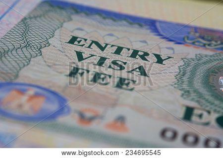 Entry Visa Fee Stamp In Passport Close-up