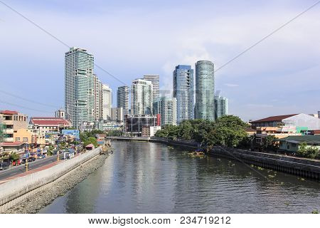 Manila - June 12: The Pasig River In Makati Passing  By High Rise Condo Buildings Of Rockwell Distrc