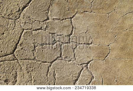 Detail Of The Cracked Surface Of The Old Desolated Wall Of A Ruined House