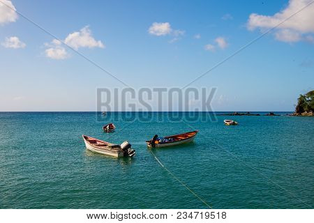 Fishing Boats In Blue Sea On Sunny Sky In Castries, St.lucia. Summer Vacation In Tropics. Fishing An