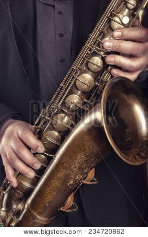 Saxophone Player Jazz Music Instrument. Alto Sax Musical Instrument Closeup