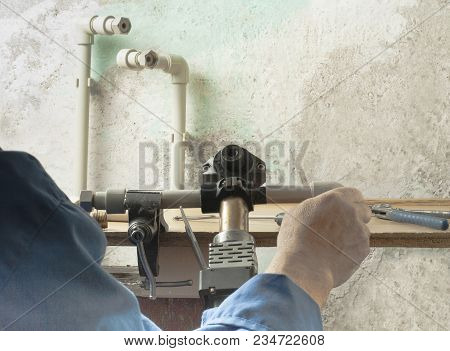 The Worker Soldered The Plastic Pipes For Water Supply With A Soldering Iron.copy Space For Text. Re