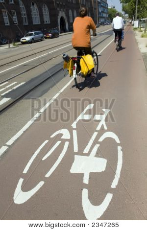 urban lifestyle: couple biking in Amsterdam the Netherlands poster