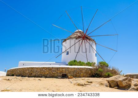 Famous Traditional Windmill On Mykonos Island. The Windmills Can Be Seen From Every Point Of The Vil
