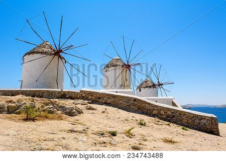 Famous Traditional Windmills On Mykonos Island. The Windmills Can Be Seen From Every Point Of The Vi
