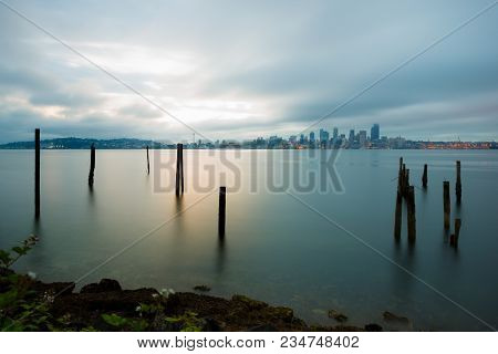 Puget Sound And City Skyline Of Seattle In The Mist Of The Early Morning, Washington State, Usa
